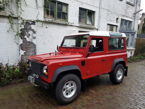 low mileage defender portofino red